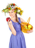 Beautiful girl with flowers and apples Royalty Free Stock Image