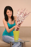 Beautiful girl with flowers. Beautiful young woman arranging flo Stock Photography