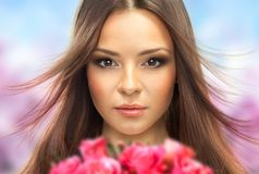 Beautiful Girl With Flowers. Beauty Model Woman Face. Styled Fashion Portrait. Professional Make-up.Makeup Stock Photos
