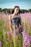 Beautiful girl on the flowers field Stock Image