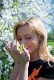 The beautiful girl among flowers in garden stock image