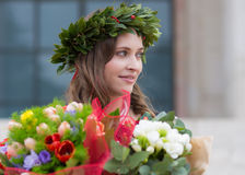 Beautiful girl with flowers graduated Royalty Free Stock Images