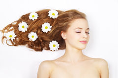 Beautiful girl with flowers in hair Stock Images