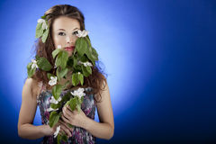 Beautiful girl with flowers in hair and hands, glamour skin Royalty Free Stock Image