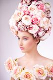 Beautiful  girl with flowers hair, makeup and silk skin Stock Image