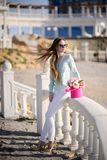 Beautiful girl with flowers in hands outdoors. Spring sunny day stock photos