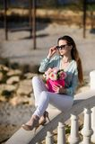 Beautiful girl with flowers in hands outdoors. Spring sunny day royalty free stock photo