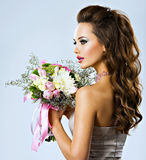 Beautiful girl with flowers in hands Stock Photos