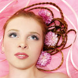 Beautiful girl with flowers on her hair Stock Photo