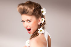 Beautiful girl with flowers in her hair Royalty Free Stock Images