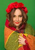 Beautiful girl with flowers in her hair hiding a blanket Royalty Free Stock Images