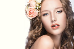 Beautiful girl with flowers in her hair and pink makeup. Spring image. Beauty face. Royalty Free Stock Images