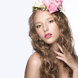Beautiful girl with flowers in her hair and pink makeup. Spring image. Beauty face. Stock Photos