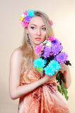Beautiful girl with flowers in her hair. Spring Stock Image