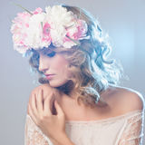 Beautiful girl with flowers in her hair. Stock Images