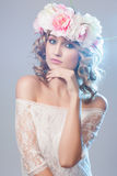 Beautiful girl with flowers in her hair. Stock Photography