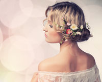 Beautiful girl with flowers in her hair. Stock Photo