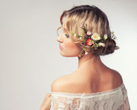 Beautiful girl with flowers in her hair. Royalty Free Stock Photos