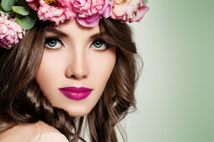 Beautiful Girl with Flowers. Makeup and Hairstyle Royalty Free Stock Photos