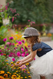 Beautiful girl in flowers park. Photo of little beautiful girl in flowers park Stock Photo