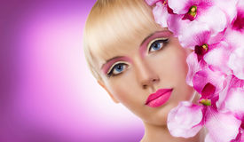 Beautiful blonde girl with flowers and perfect makeup Royalty Free Stock Photography