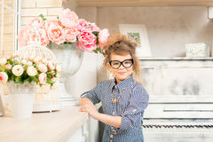 Beautiful girl with flowers at the piano Stock Photo