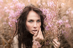 Beautiful girl among the flowers royalty free stock photos