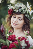 Beautiful girl with flowers. Portrait of young beautiful girl with flowers in circlet of flowers Royalty Free Stock Photography