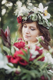 Beautiful girl with flowers. Portrait of young beautiful girl with flowers in circlet of flowers Stock Photos