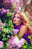 Beautiful girl with flowers. Stock Photos