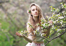 Beautiful girl with flowers. Beautiful girl in the spring garden with flowers Stock Photo
