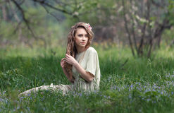 Beautiful girl with flowers. Beautiful girl in the spring garden with flowers Royalty Free Stock Photo