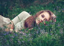 Beautiful girl with flowers. Beautiful girl in the spring garden with flowers Stock Images