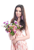 Beautiful girl with flowers on a white background Royalty Free Stock Photography