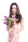 Beautiful girl with flowers on a white background Royalty Free Stock Image