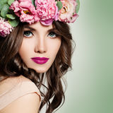 Beautiful Girl with Flowers Wreath. Long Permed Curly Hair Royalty Free Stock Image