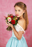 The beautiful girl with flowers Royalty Free Stock Images