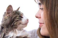Beautiful girl with fluffy kitten in her arms Stock Photo