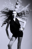 Beautiful girl with flying blond hair Royalty Free Stock Images
