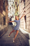 Beautiful girl flying through Cagliari streets in Sardinia Royalty Free Stock Photos