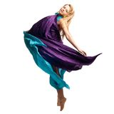 Beautiful girl in flying dress. Isolated Royalty Free Stock Photography