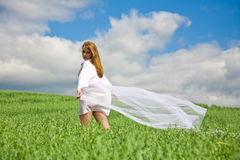 Beautiful girl with flying white shawl Royalty Free Stock Image