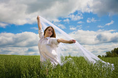 Beautiful girl with flying white shawl Royalty Free Stock Images