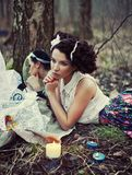A beautiful girl in the forest burns letters Royalty Free Stock Photography