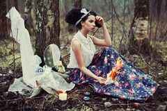 A beautiful girl in the forest burns letters Royalty Free Stock Photos