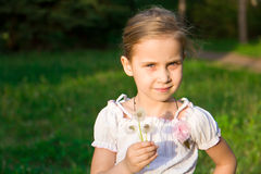 Beautiful girl in the forest with dandelion Royalty Free Stock Images