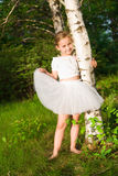 Beautiful girl in the forest near birch Royalty Free Stock Image