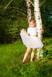Beautiful girl in the forest near birch Royalty Free Stock Photo
