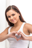 Beautiful girl forming heart with her hands. Stock Photography