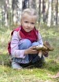 Beautiful girl found mushrooms Royalty Free Stock Photos